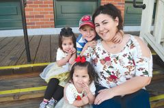 Recent graduate Cynthia Miller and her children. The award-winning organization has graduated 1,503 homeless women and their children. Last year, 92 percent of graduates found homes and 77 percent found jobs or enrolled in school or training.