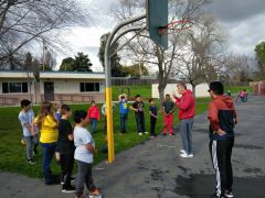Coach Roz and Peter Francisco teaching the Playmakers of Skycrest Elementary how to properly run basketball drills.