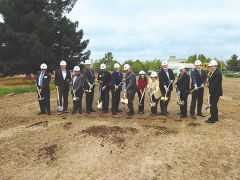Many of the leaders of the project, along with city officials, joined together to break ground on the next phases of Veterans Village. Photo by Paul Scholl