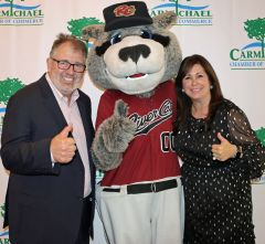 A surprise guest, River Cats mascot Dinger posed with dentist Kevin Tanner and Chamber of Commerce President Gabrielle Rasi.