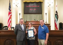 Assemblyman Ken Cooley, Koobs Nature Area Chairperson Linda Jones and Kiwanis Club President Wayne Lang stand proud as the Earl J. Koobs Nature Area is recognized as the 8th Assembly District's 2018 Nonprofit of the Year.