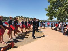 Surrounded by Lifeguards and Cordova High students, (L-R) Chris Dargan of Metro Fire and State Park Peace Officer Josh Neff explained the importance of water safety.