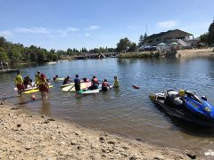 Students learned how to safely paddle out among other important water safety skills.