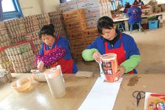 Inside the Hengda Fireworks factory in China, workers add the final elements to Phantom Fireworks' best-selling Brew Haha.