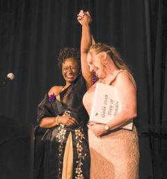 Women's Empowerment graduates celebrate overcoming homelessness in front of 500 attendees at the organization's 17th Annual Gala in May. Photo by Jon Wallenhaupt
