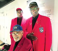 Tuskegee Airman George Hudson seated - Perry Woods and Col James C Crump Jr USAF (Ret) in back row.