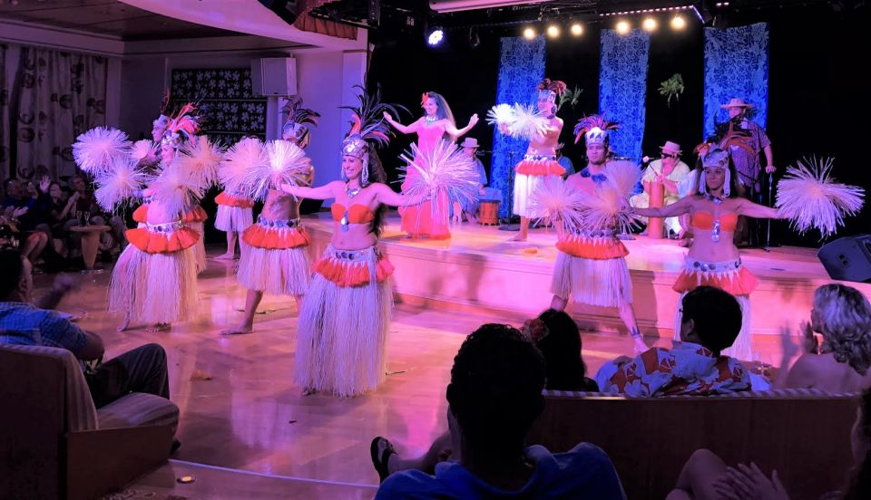 Paul Gauguin cruisers enjoy an authentic Polynesian revue.