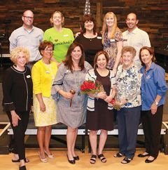 Carmichael Chamber of Commerce Directors joined CEO Linda Melody (center, with bouquet) at the September business luncheon. Melody announced her departure after nine years at the organization helm.