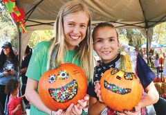Carmichael friends Yana Sullivan and Allie Olson got creative with pumpkin painting at the Carmichael Farmers Market.  Jason Rose and Pomeranian/chihuahua Sarah won first prize and many hearts with a panda-pooch ensemble.