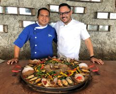 Chef Albis Salas (right) and sous chef Ramon Bramasco make a mean seafood paella at Las Calitas. Photo by David Dickstein