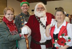 Festival founder Heidi Cadena (left), Pastor Richard Reimer and vendor Inge Inge Baylocq welcomed Santa Claus to the Walnut Avenue church gymnasium.