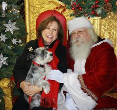 County Supervisor Susan Peters and puppy Phoebe share Christmas wishes with the North Pole Ambassador. Photo by Susan Maxwell Skinner