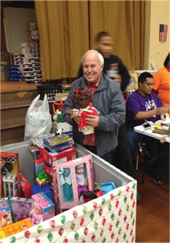 Carl Burton bringing toys to Camp Fire Children.
