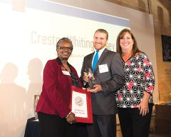 Creston Whiting-Casey of Rancho Cordova receives United Way's Young Leaders Society Member of the Year Award from president and CEO Stephanie Bray and board chair Julie Quinn at a recognition event earlier this month. Photo courtesy Kristin Thébaud