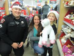 Officer Parsons with STAR Lynnae and mom Annette. Photo by Trins Drotat