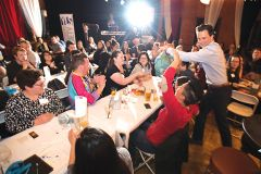 Teams of young professionals works together to solve a round of trivia over beers and dinner at United Way's Young Leaders Society's Brews & Brains fundraiser. Photo courtesy Thébaud Communications