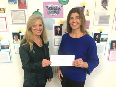 Lisa Culp of Women's Empowerment receives a check from Jessica Cook of U.S. Bank for Women's Empowerment's career-readiness, job training and financial literacy programs for women who are homeless.  Photo courtesy Thébaud Communications