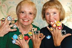 Faye Wolfe (left) and Susan Rhoades display some of thousands of antique and retro buttons that will be exhibited at the California Button Society's March 9 show. Photo by Susan Skinner