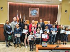 Members of Citrus Heights City Council stand with the 13 student winners of Republic Services' annual Poster Contest.