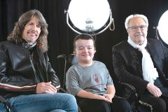 Foreigner band members Kelly Hansen (Foreigner lead singer, left) and Mick Jones (Founding band member and song writer, right) pose with Alec Cabacungan, Shriners Hospitals for Children Patient Ambassador. Photo courtesy Shriners Hospital.