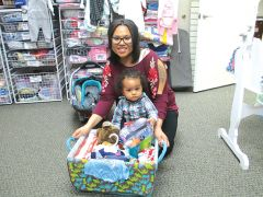 Ana Alvarado receives a baby basket from Sacramento Life Center, thanks to the group's Baby Basket Drive held each December. Photo courtesy Thébaud Communications
