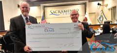 Troy Givans, left, and Supervisor Patrick Kennedy present the ceremonial 2018 Employee Giving Campaign check on Tuesday, Jan. 29, 2019.  Photo courtesy Sacramento County
