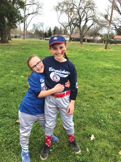 Morgan and Chloe Miller are learning good sportsmanship, camaraderie, and friendship through their participation in Carmichael Girls Softball. Photo provided by Carmichael Girls Softball.