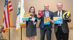 Ashley Downton, Marc Sapoznik, Mayor McGarvey rocking the blue and gold. Photos by Rick Maness