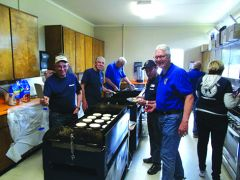 Ron Greenwood (center) and the Kiwanis crew prepares the pancakes for the breakfast held on Saturday, April 20, 2019.