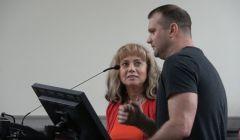 An interpreter helps a Russian speaker address the Board on April 23, 2019