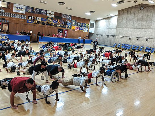Participants warm up with exercises in the gym before hitting the field. Photo by Shaunna Boyd