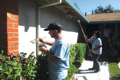 Volunteers from the Rebuilding Together program painting houses in Rancho Cordova.