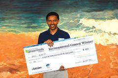 Abel Asrese holding his Big Award Check. Photo by Nina Suzuki