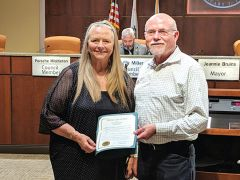 John Foley (left) of Sacramento Self Help Housing accepts a proclamation affirming the City's support of Fair Housing Month. Mayor Jeannie Bruins (right) recognized the organization's important role in protecting tenant rights.