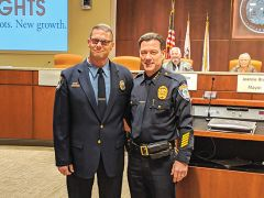 Dispatcher Scott Kermgard, the CHPD awards recipient, standing with Police Chief Ron Lawrence.