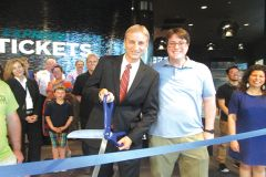 Cinema West CEO Dave Corkill prepares to cut the ribbon.