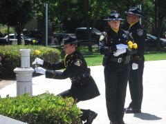 Placing of yellow roses on each memorial during the reading of the names – after placing, a moment to honor the fallen officer, then a salute.