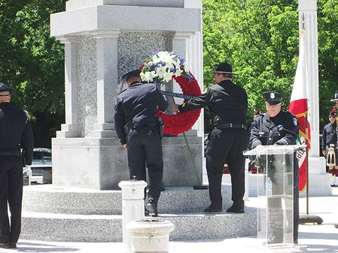 Placing the Remember the Fallen Wreath at the Woodlake Monument of Remembrance.