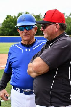 Coaches Guy Anderson and Doug Hughes meet to talk. Photo by Rick Sloan
