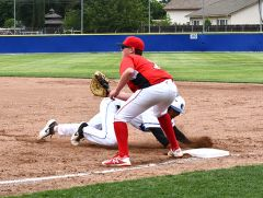 Dylan Nester holds a runner at 1st base. Photo by Rick Sloan.