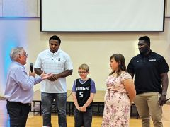 Phil Oates, part-owner of the Sacramento Kings, introduced Playmaker participants Jeremy and Clarissa to Stanford defensive linemen Jovan Swahn (second from left) and Michael Williams (right).