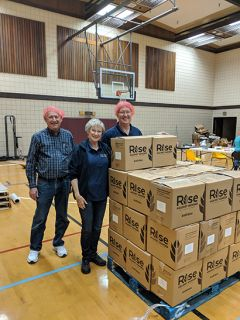 Rotary members stack boxes of packaged meals onto a shipping pallet for distribution to developing countries. Photo by Shaunna Boyd