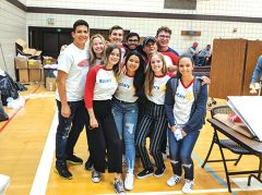 Rotary Exchange students from countries around the world helped package meals at the Rise Against Hunger event. Photo by Shaunna Boyd
