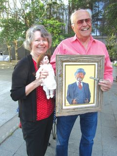 """Al and Virginia show off their treasures – a French doll that is actually German, a Jerry Crandall painting paid for legal services with a tiny pistol that Al said """"allegedly a lawyer carried this with him."""