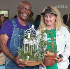 Grower and artist Merlyn Lenear was among vendors at the two-day show. His customer was Fair Oaks succulent fan Barbi Brown.