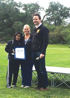 Melissa Washington, Founder of the Women Veterans Alliance and Assemblyman Kevin Kiley presenting Maya Washington with an award for top fundraiser. Photo courtesy of Rachael DiCicco, Ford Motor Company