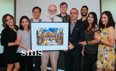 Artist David Peterson's watercolor vision of Carmichael's Milagro Centre was auctioned and won by a $500 bid from Dr. Ashkan Alizadeh. Alizadeh's Marconi Dental group also took best dentist honors.