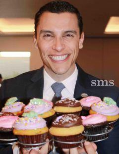 Carmichael Chamber of Commerce President Jim Alves holds all the cupcakes!