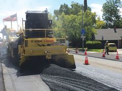 Image of a road repair crew filling in trenches on one of our roadways. Photo courtesy of Sacramento County.