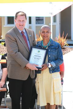 Citrus Heights City Manager Chris Boyd presents Connie Turner, wife of deceased former Citrus Heights councilman, Mel Turner with the official dedication plaque for Turner Court, a street in the new Mariposa Creek development. Photo courtesy of City of Citrus Heights